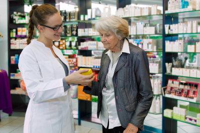 pharmacist giving advise to senior woman for best medication